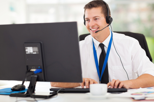 handsome technical support operator working on computer