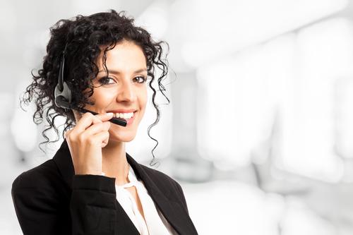 Portrait of a beautiful customer representative woman at work