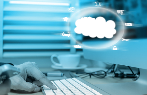 Cloud technology over the finger pressing the computer keyboard blurred background, business technology concept